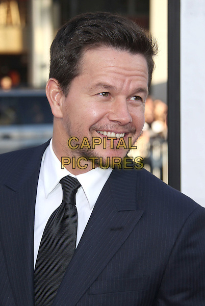 Mark Wahlberg.The L.A. Premiere of 'Ted' held at The Grauman's Chinese Theatre in Hollywood, California, USA..June 21st, 2012.headshot portrait tie white shirt stubble facial hair blue suit black  .CAP/ADM/RE.©Russ Elliot/AdMedia/Capital Pictures.