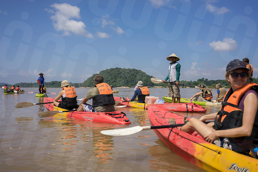 November 5, 2014 - Preah Rumkel, Stung Treng (Cambodia). A group of tourists enjoys a kayak tour in the water of the Anlung Cheauteal Pool, on the border between Laos and Cambodia. The majority of the foreigner tourists who visit this area, are backpackers from Laos.