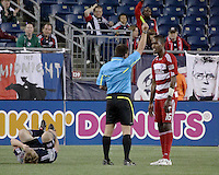 The referee Jeff Gontarek issues a yellow card to FC Dallas midfielder/forward Atiba Harris(16).  He issued a total of 2 red cards and 10 yellow cards (5 to each team) during the game.  The New England Revolution drew FC Dallas 1-1, at Gillette Stadium on May 1, 2010