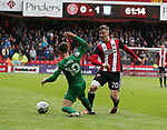 Lee Evans of Sheffield Utd passes past Josh Harrop of Preston North End during the championship match at the Bramall Lane Stadium, Sheffield. Picture date 28th April 2018. Picture credit should read: Simon Bellis/Sportimage