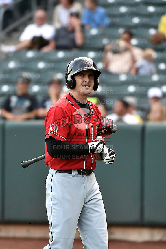 Tyler Greene (16) of the El Paso Chihuahuas at bat against the Salt Lake Bees in Pacific Coast League action at Smith's Ballpark on August 7, 2014 in Salt Lake City, Utah.  (Stephen Smith/Four Seam Images)