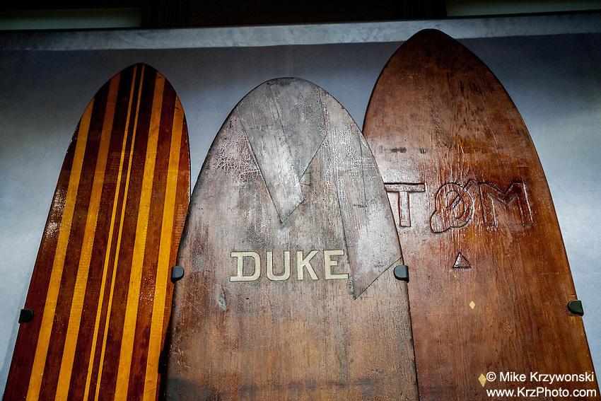 Duke Kahanamoku's wooden surfboard exhibit at Bishop Museum, Honolulu