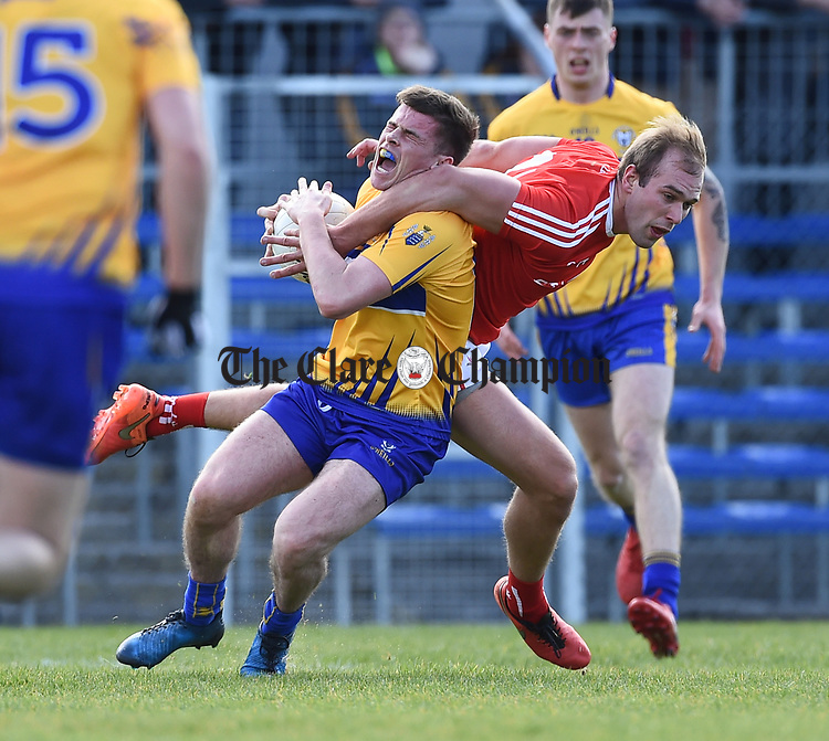 Sean Collins of Clare in action against Conor Grimes of Louth during their national League game in Cusack Park. Photograph by John Kelly.