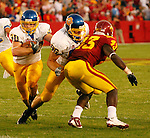 South Dakota State's Luke Greving blocks to allow Kyle Minett to pass around Iowa State defender Fred Garrin during the second quarter of their game Thursday evening at Jack Trice Stadium in Ames, IA.  (Photo By Ty Carlson/South Dakota State Sports Information)