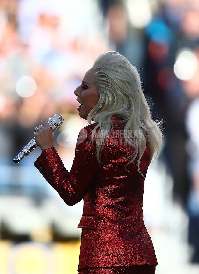 Feb 7, 2016; Santa Clara, CA, USA; Recording artist Lady Gaga performs the national anthem before Super Bowl 50 between the Carolina Panthers and the Denver Broncos at Levi's Stadium. Mandatory Credit: Mark J. Rebilas-USA TODAY Sports