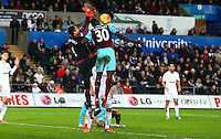 Lukasz Fabianski of Swansea City and Michail Antonio of West Ham United challenge for the ball during the Barclays Premier League match between Swansea City and West Ham United played at The Liberty Stadium, Swansea on 20th December 2015