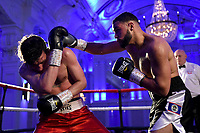 Kayleem Foreman (black shorts) defeats Scott Hillman during a Boxing Show at The Devere Grand Connaught Rooms on 9th May 2019