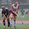 Julianne Larsson #10 of Garden City, right, gets pressured by Kelsi King #5 of Baldwin during a Nassau County Conference I varsity field hockey match at Garden City High School on Friday, Sept. 30, 2016. Larsson scored two goals in Garden City's 7-0 win.