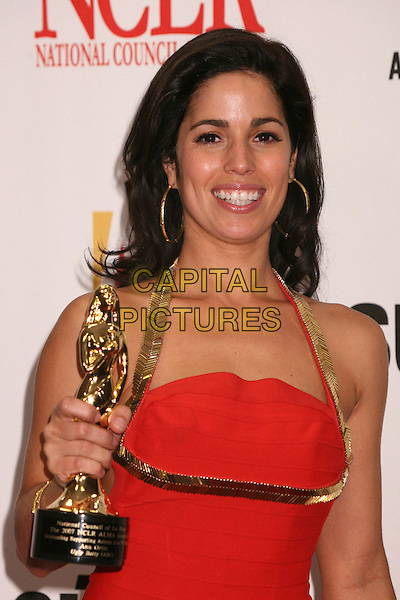 ANA ORTIZ.2007 NCLR ALMA Awards at the Pasadena Civic Center, Pasadena, California, USA..June 1st, 2007.half length red gold halterneck award trophy dress hoop earrings .CAP/ADM/BP.©Byron Purvis/AdMedia/Capital Pictures