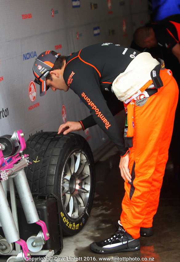 Jamie Whincup inspects his tyres. V8 Supercars - ITM 400 day two at Hamilton Street Circuit, Hamilton, New Zealand on Saturday, 16 April 2011. Photo: Dave Lintott / lintottphoto.co.nz