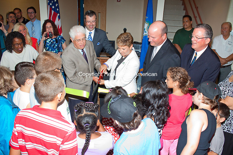 WATERBURY CT.-22 AUGUST 2013 082213DA02- President of the Waterbury Board of Education Charles Stango and Waterbury Superintendent of Schools Dr. Kathleen M. Ouellette cut a ribbon along side of other officials as students of the new Carrington Elementary School took part in holding the ribbon during the ceremony on Thursday.  The new school is for students Pre-K through eighth-grade. <br /> Darlene Douty Republican American