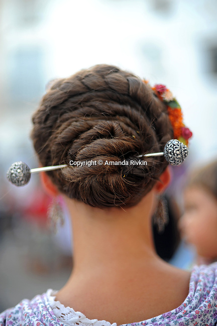 The traditional hairstyle of Valencian women is seen in the main square during the municipal fiestas in Costur, Spain on August 15, 2009.