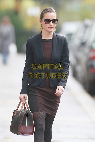 Pippa Middleton arrives for work,.London, England..November 9th, 2011.half 3/4 length sunglasses shades black blazer brown skirt pattern tights bag purse  .CAP/HIL.©John Hillcoat/Capital Pictures .