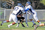 Palos Verdes CA 10/22/10 - Josh Mcguiness (Peninsula #3),Cheyanne Bates (Leuzinger #17), Omar Bucio (C) (Leuzinger #44) in action during the Leuzinger - Peninsula varsity football game at Palos Verdes Peninsula High School.