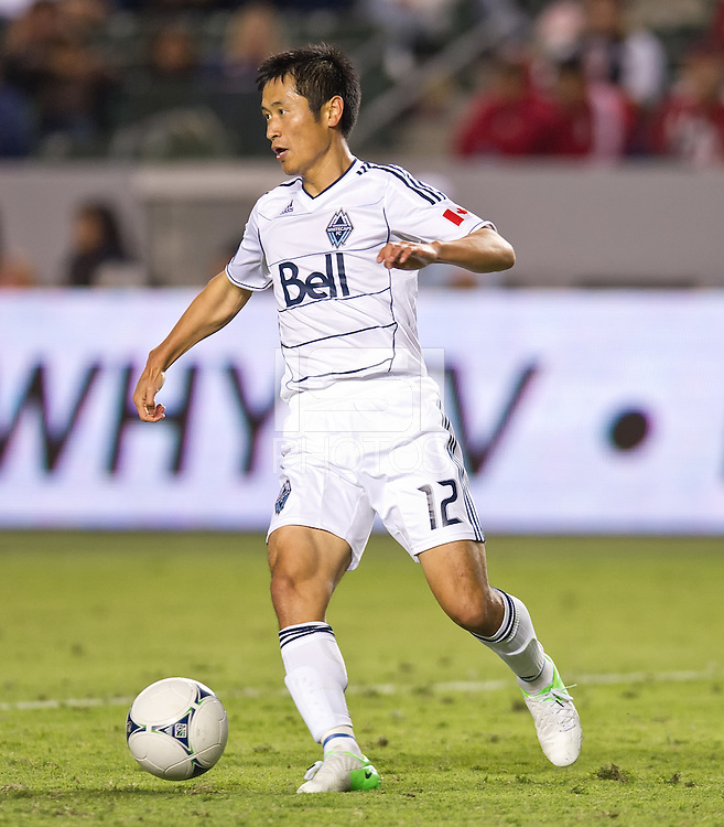 CARSON, CA - July 7, 2012: Vancouver Whitecaps defender Lee Young-Pyo (12) during the Chivas USA vs Vancouver Whitecaps FC match at the Home Depot Center in Carson, California. Final score Vancouver Whitecaps FC 0, Chivas USA 0.