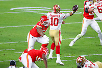2nd February 2020, Miami Gardens, Florida, USA;   Kansas City Chiefs Defensive Tackle Mike Pennel (64) pressures San Francisco 49ers Quarterback Jimmy Garoppolo (10) who throws an interception during the first quarter of Super Bowl LIV on February 2, 2020 at Hard Rock Stadium in Miami Gardens