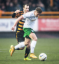 Hib's Jason Cummings tries to gets away from Alloa's Graeme Holmes.
