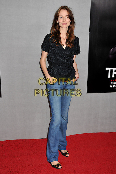 "SAFFRON BURROWS .""True Blood"" 2nd Season Premiere held at Paramount Studios, Los Angeles, CA, USA..June 9th, 2009.full length jeans denim black top hands in pockets .CAP/ADM/BP.©Byron Purvis/AdMedia/Capital Pictures."