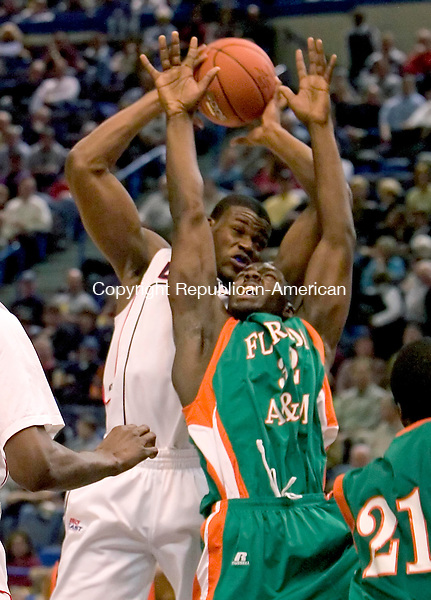 HARTFORD --26 NOVEMBER 2007-112607JS07-<br /> UConn's Jeff Adrien pulls down an ofensive rebound beind Florida A&amp;M's Larry Jackson during their game Monday at the Hartford Civic Center.<br />  Jim Shannon/Republican-American