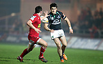 Tiernan O'Halloran chips the ball past Adam Warren..RaboDirect Pro12.Scarlets v Connacht.02.03.12.©STEVE POPE