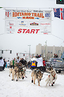 Cim Smyth and team leave the ceremonial start line at 4th Avenue and D street in downtown Anchorage during the 2013 Iditarod race. Photo by Jim R. Kohl/IditarodPhotos.com