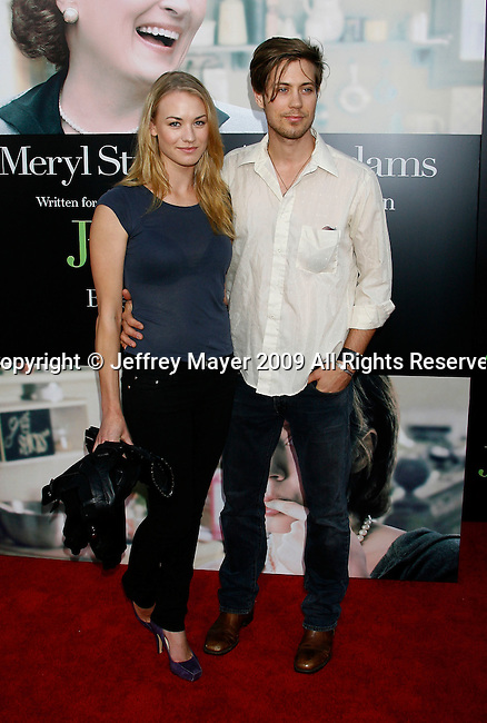 """WESTWOOD, CA. - July 27: Yvonne Strahovski and Tim Loden arrive at the Los Angeles screening  of """"Julie & Julia"""" at the Mann Village Theatre on July 27, 2009 in Westwood, California."""