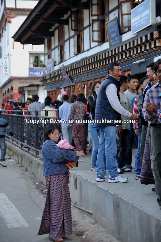A Bhutanese lady with her child wearing national dress Kira at Thimpu market. Arindam Mukherjee..