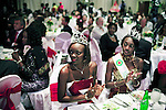 KINSHASA, DEMOCRATIC REPUBLIC OF CONGO APRIL 21: Unidentified beauty queens watch the Miss Congo Contest on April 21, 2006 in central Kinshasa, Congo, DRC. About twenty girls from all over Congo, DRC competed to win the crown at the ballroom at the Grand Hotel in Kinshasa. Diane Muzungu from the Katanga province won. Congo DRC, returned to the Miss World contest only in 2005, after almost two decades absence. Kinshasa, a city of about eight million people is battling with bad infrastructure and no public transport. Congo, DRC is in ruins after forty years of mismanagement by the corrupt dictator and former president Mobuto Sese Seko. He fled the country in 1997 and a civil war started. The country is planning to hold general elections by July 2006, the first democratic elections in forty years.(Photo by Per-Anders Pettersson)