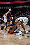 Doral Moore (4) of the Wake Forest Demon Deacons battles for a loose ball with Nikola Djogo (13) of the Notre Dame Fighting Irish during second half action at the LJVM Coliseum on February 24, 2018 in Winston-Salem, North Carolina. The Fighting Irish defeated the Demon Deacons 76-71.  (Brian Westerholt/Sports On Film)