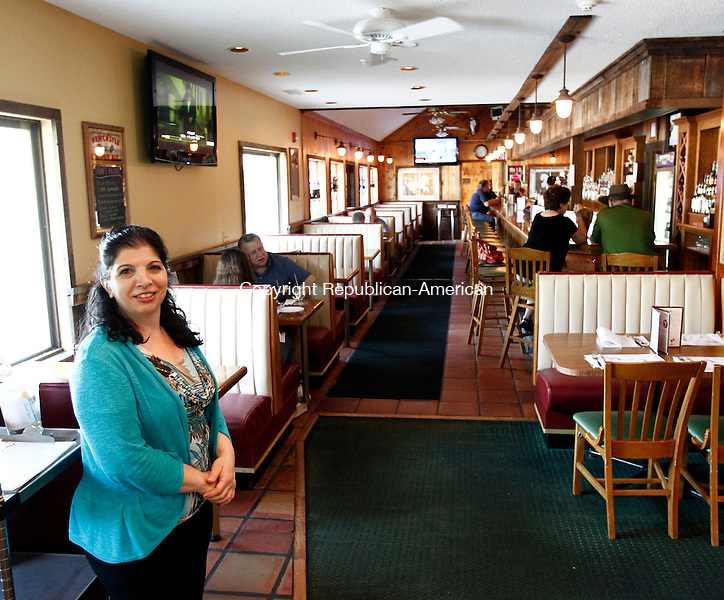 Bethlehem, CT- 25 July 2014-072514CM02-  Jeannie McColgan, left, stands inside a dining area inside the Painted Pony Restaurant in Bethlehem on Friday.  McColgan has taken over ownership of the restaurant.  Christopher Massa Republican-American