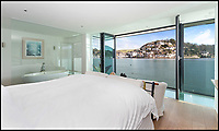 BNPS.co.uk (01202 558833)<br /> Pic: Savills/BNPS<br /> <br /> Sea views from the master bedroom...<br /> <br /> An award-winning waterfront home that has spectacular seaside views has gone on the market for £5m.<br /> <br /> The aptly named River House sits right on the Dart Estuary in Devon and has been so cleverly designed there is a glass floor in the master bedroom that looks down on the water.<br /> <br /> Its main living areas have floor-to-ceiling bi-fold doors and glass Juliet balconies to give the property a feel of Venice rather than Devon.<br /> <br /> Interestingly, the five bedroom house is being sold along with a nearby two bedroom town house that is owned by the same vendors.