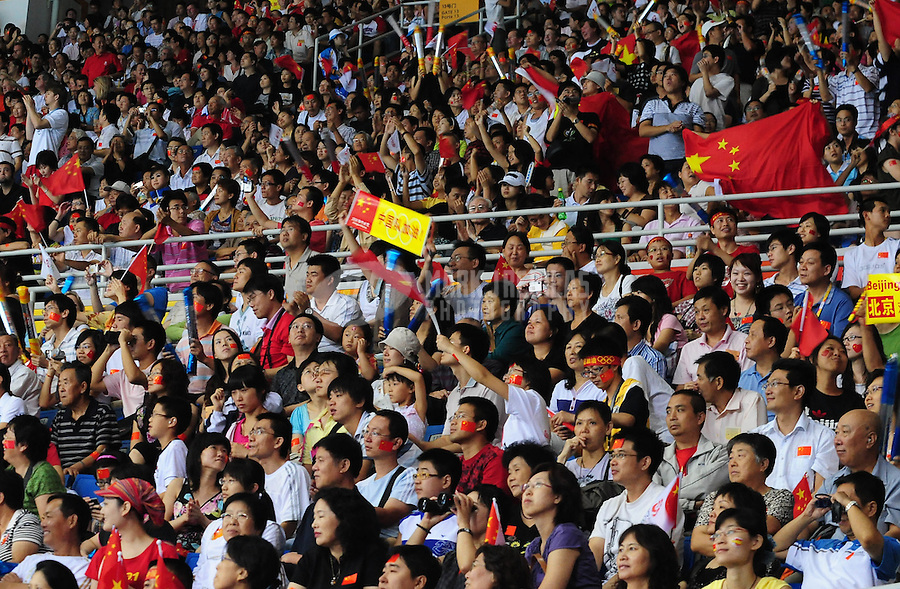 Aug. 15, 2008; Beijing, CHINA; China fans cheer during the match against USA during womens volleyball pool play match at the Capital Gymnasium during the 2008 Beijing Olympic Games. Mandatory Credit: Mark J. Rebilas-