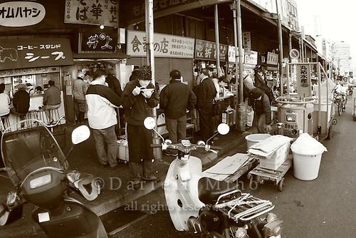 Mar 4, 2006; Tokyo, JPN; Tsukiji.Street scene in Tsukiji.  Locals enjoy a bowl of noodles for breakfast...Photo credit: Darrell Miho