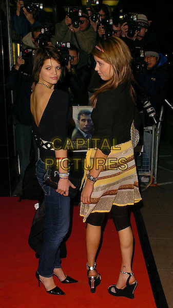 PIXIE GELDOF &amp; PEACHES GELDOF<br /> &quot;Derailed&quot; UK film premiere at Curzon Mayfair, London, UK.<br /> January 23rd, 2006<br /> Ref: CAN<br /> full length black top jeans skirt yellow brown striped stripes profile sisters siblings family wedges backless<br /> www.capitalpictures.com<br /> sales@capitalpictures.com<br /> &copy; Capital Pictures