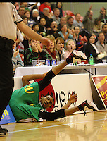 Jets import Daryl Hudson falls into the advertising after being fouled by Dillon Boucher during the NBL match between Manawatu Jets and Harbour Heat at Arena Manawatu, Palmerston North, New Zealand on Saturday 17 April 2010. Photo: Dave Lintott / lintottphoto.co.nz