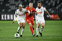 30th July 2020; Bankwest Stadium, Parramatta, New South Wales, Australia; A League Football, Adelaide United versus Perth Glory; Riley McGree of Adelaide United is eased off the ball by Osama Malik and Jacob Tratt of Perth Glory