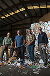Bellingham Public Works Director Ted Carlson, Northwest Recycling CEO Kevin Moore, Northwest Recycling Operations Manager Marty Kuljis and Sanitary Service Company Recycling Manager Rodd Pemble, photographed at Northwest Recycling in Bellingham, Wash. Bellingham is one of only a handful of cities in Washington state without single-stream recycling, so residents must sort their recyclable items into three separate bins. <br /> Photo by Daniel Berman