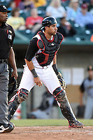 Lansing Lugnuts catcher Santiago Nessy (14) checks the runners after blocking a pitch in the dirt during a game against the South Bend Silver Hawks on June 6, 2014 at Cooley Law School Stadium in Lansing, Michigan.  South Bend defeated Lansing 13-5.  (Mike Janes/Four Seam Images)