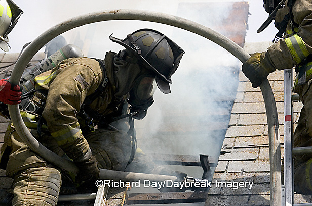 63818-021.15 Firefighters on roof fighting fire at house fire,  Marion Co. IL