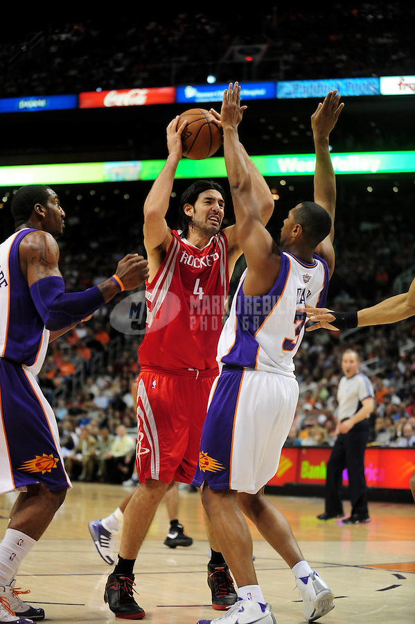 Mar. 22, 2008; Phoenix, AZ, USA; Houston Rockets forward (4) Luis Scola drives to the basket under pressure from Phoenix Suns guard (3) Boris Diaw at the US Airways Center. Mandatory Credit: Mark J. Rebilas
