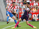 Sporting de Gijon's Burgui (l) and FC Barcelona's Sergio Busquets during La Liga match. September 24,2016. (ALTERPHOTOS/Acero)