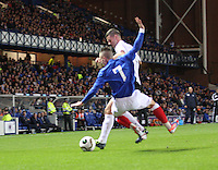 Barrie McKay sent flying by Mark Durnan in the Rangers v Queen of the South Quarter Final match in the Ramsdens Cup played at Ibrox Stadium, Glasgow on 18.9.12.