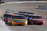 Nov. 1, 2009; Talladega, AL, USA; NASCAR Sprint Cup Series driver Jamie McMurray (left) leads Kasey Kahne (right) during the Amp Energy 500 at the Talladega Superspeedway. Mandatory Credit: Mark J. Rebilas-