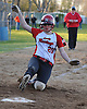 Holly McNair #20 of Mount Sinai slides home safely on a sacrifice fly by Hailey LaGiudice #14 (not pictured) that tied the game 9-9 in the bottom of the sixth inning of a a non-league varsity softball game against Sayville at Mount Sinai High School on Wednesday, Apr. 13, 2016. Mount Sinai went on to win 10-9.