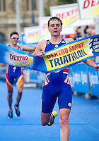 11 SEP 2010 - BUDAPEST, HUN - Britain's Alistair Brownlee wins the 2010 Elite Mens ITU World Championship Series Triathlon final ahead of the overall series winner, Spain's Javier Gomez .(PHOTO (C) NIGEL FARROW)