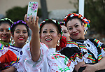 Dancers with the Ballet Folklorico International in Reno take a selfie at the Posada Celebration at Western Nevada College in Carson City, Nev., on Saturday, Dec. 16, 2017. The holiday event, hosted by the Latino Cohort, includes traditional  Latino food, games and dancing.<br /> Photo by Cathleen Allison/Nevada Momentum