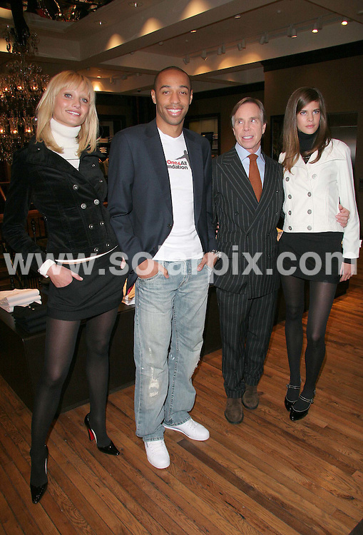 ALL ROUND PICTURES FROM SOLARPIX.COM.WORLDWIDE SYNDICATION RIGHTS.Thierry Henry has announced a new partnership with American clothing giant Tommy Hilfiger. The Arsenal and French International striker is presently recovering from a neck injury but was present at the launch of the new fashion line: THe One 4 All Foundation in London on 05.12.06.  All proceeds from the fashion range will go to THe One 4 All Foundation charity which will endeavor to tackle racism and social inequality among the young and under-privileged..THe One 4 All Foundation (playing on the striker's initials and shirt number 14), plans to fund sports and educational projects in Europe and Africa. DATE: 05/12/2006-JOB REF: 3141-SSD.**MUST CREDIT SOLARPIX.COM OR DOUBLE FEE WILL BE CHARGED**
