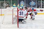 Doug Carr (UML - 31), Zach Aston-Reese (NU - 12), Scott Wilson (UML - 23) - The Northeastern University Huskies defeated the University of Massachusetts Lowell River Hawks 4-1 (EN) on Saturday, January 11, 2014, at Fenway Park in Boston, Massachusetts.