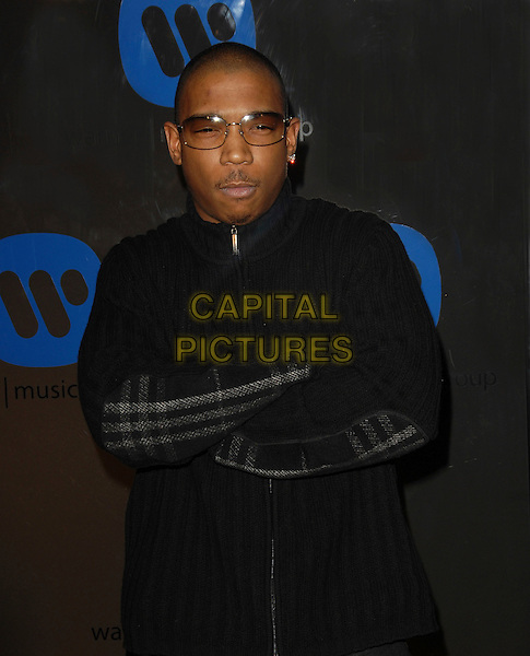 JA RULE.The Warner Music Group Post Grammy Party held at The Pacific Design Center in Beverly Hills, California  .February 8th, 2006.Ref: DVS.half length black arms crossed sunglasses shades.www.capitalpictures.com.sales@capitalpictures.com.Supplied By Capital PIctures