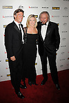 HOLLYWOOD, CA - January 22: John Easterling, Olivia Newton-John and Barry Gibb arrive at the G'Day USA Australia Week 2011 Black Tie Gala at the Hollywood Palladium on January 22, 2011 in Hollywood, California.